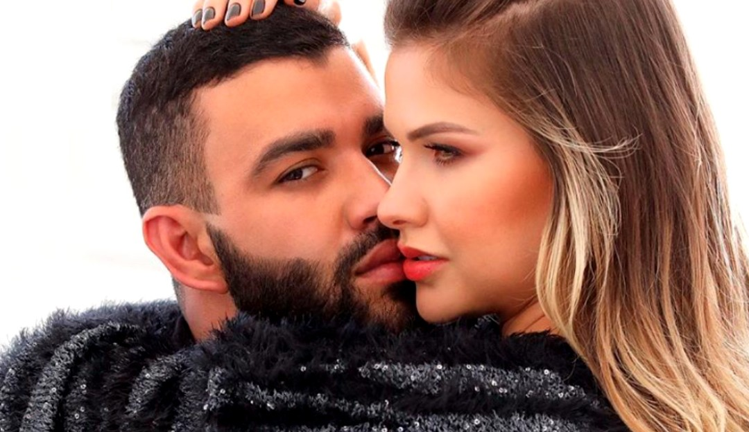 Gusttavo Lima aparece segurando a mão de uma mulher e fãs especulam ser Andressa Suita